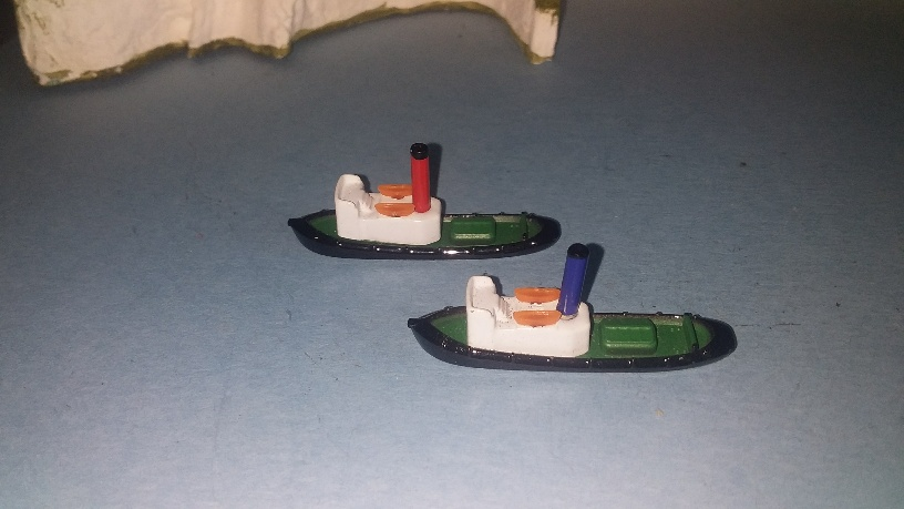 Steam tugs 1 x red funnel , 1 x blue funnel *